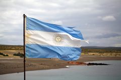 Flag of Argentina at Punta Tombo in the Atlantic Ocean, Patagonia, Argentina. Flag of Argentina at Punta Tombo, the peninsula into the Atlantic Ocean, south of Stock Photos