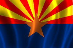 The flag of  Arizona with waves. The flag of Arizona consists of 13 rays of red and weld-yellow on the top half, the colors of the flag of Spain, representing Royalty Free Stock Image