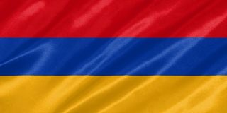 Armenia Flag. Waving on satin texture royalty free stock photos
