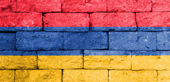 Flag of Armenia on old brick wall. Royalty Free Stock Photo