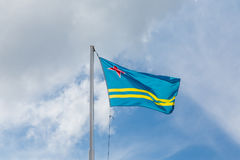 Flag of Aruba Under Clouds Royalty Free Stock Photography