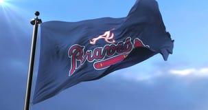 Flag of the Atlanta Braves, american professional baseball team, waving - loop. Flag of the team of the Atlanta Braves, american professional baseball team stock video footage