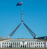 Flag atop the Australian Parliament Building. The large Australian flag flying over the landmark Parliament Building in Canberra Stock Image