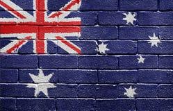 Flag of Australia on brick wall. Flag of Australia painted onto a grunge brick wall Royalty Free Stock Image