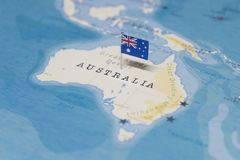 The Flag of australia in the world map stock image