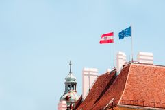 Flag of Austria and flag of the European Union on the roof. Flag Stock Image
