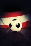 Flag of Austria with football on wooden boards. Stock Image