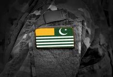 Flag of Azad Kashmir on soldiers arm. Flag of Azad Jammu and Kashmir on military uniform collage.  stock photos
