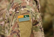 Flag of Azad Kashmir on soldiers arm. Flag of Azad Jammu and Kashmir on military uniform collage.  royalty free stock image