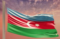 Flag of Azerbaijan on cloudy sky. Patriotism stock image