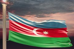 Flag of Azerbaijan on cloudy sky. Patriotism stock photo