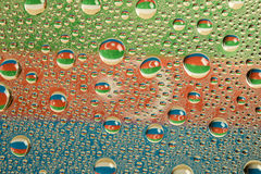 Flag of Azerbaijan in droplets of water, creative shot Stock Photo