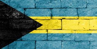 Flag of Bahamas on old brick wall. Stock Image