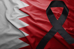 Flag of bahrain with black mourning ribbon. Waving national flag of bahrain with black mourning ribbon Royalty Free Stock Images