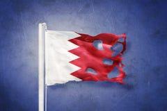Flag of Bahrain flying against grunge background Stock Photography