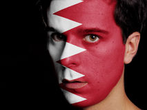 Flag of Bahrain. Painted on a Face of a Young Man Royalty Free Stock Photography