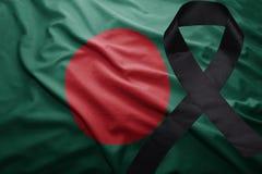 Flag of bangladesh with black mourning ribbon. Waving national flag of bangladesh with black mourning ribbon Royalty Free Stock Photos