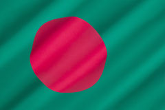 Flag of Bangladesh. The red disc, representing the sun, is off set from center on a green background representing the lush green land of Bangladesh. Adopted Stock Photos