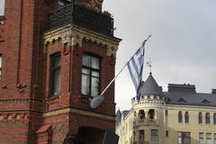 Flag, banner, checkbox. The flag that flies on one of the buildings in the city of Helsinki Finland Stock Image