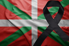 Flag of basque country with black mourning ribbon. Waving national flag of basque country with black mourning ribbon Royalty Free Stock Photos