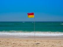 Flag on the beach Royalty Free Stock Photos