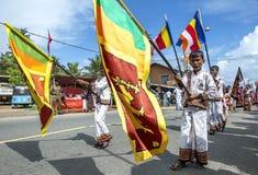 Flag bearers carrying the Sri Lankan flag during the Hikkaduwa Perahara. Stock Image