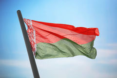 Flag of Belarus. The Belarusian flag against the background of the blue sky stock photography