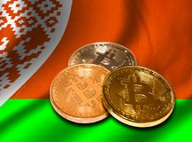 Flag of Belarus and bitcoin. Close-up Stock Images