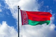 Flag of Belarus. A flying flag of the Republic of Belarus, a state of Eastern Europe royalty free stock photography