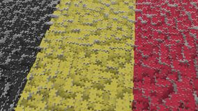 Flag of Belgium being made with jigsaw puzzle pieces. Belgian problem solution conceptual 3D rendering. Flag made of puzzle pieces, conceptual 3D royalty free illustration