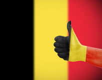 Flag of Belgium on hand. Flag of Belgium on female's hand, second defocused flag in background Stock Photography