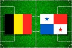 Flag Belgium - Panama on the football field. Football match.  Royalty Free Stock Photos