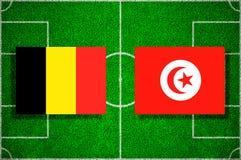 Flag Belgium - Tunisia on the football field. Football match.  Royalty Free Stock Photo