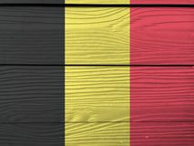 Flag of Belgium on wooden wall background. Grunge Belgium flag texture. Flag of Belgium on wooden wall background. Grunge Belgium flag texture, a vertical stock image