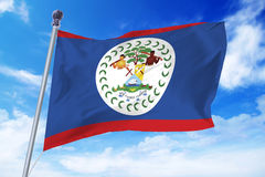 Flag of Belize developing against a clear blue sky Royalty Free Stock Photos