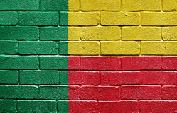 Flag of Benin on brick wall Stock Image