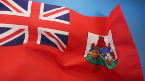 Flag of Bermuda. The Flag of Bermuda was adopted in October 1910. It is a British Red Ensign with the Union Flag in the upper left corner, and the coat of arms stock video