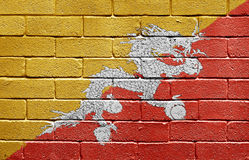 Flag of Bhutan on brick wall. Flag of Bhutan painted onto a grunge brick wall Royalty Free Stock Photography