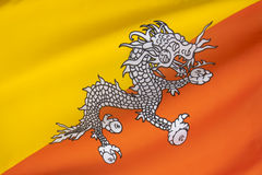 National Flag - Kingdom of Bhutan. The national flag of The Kingdom of Bhutan - The flag is based upon the tradition of the Drukpa Lineage of Tibetan Buddhism Stock Photo