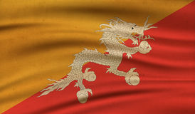 Flag of Bhutan. Vintage background with flag of Bhutan. Grunge style Stock Images