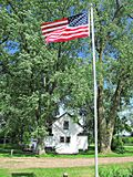 Flag Blowing in the Wind. This is a American Flag blowing on a Flag pole in the country of a home in Wisconsin Royalty Free Stock Photography
