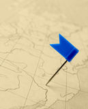 Flag blue a pin on old map Royalty Free Stock Image
