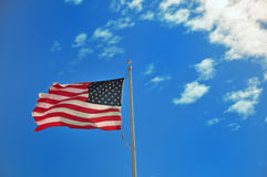 Flag on a blue sky Royalty Free Stock Image