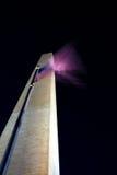 Flag blur. Washington momument at night withan american flag stock photo