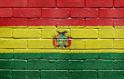 Flag of Bolivia on brick wall Stock Images