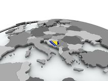 Flag of Bosnia on globe Stock Photo