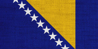 Flag of Bosnia and Herzegovina on old linen Royalty Free Stock Images
