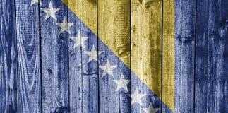 Flag of Bosnia and Herzegovina on weathered wood Royalty Free Stock Photo