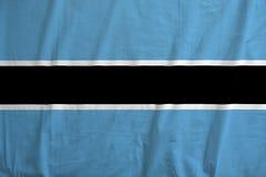 Flag of Botswana. Botswana flag on soft and smooth silk texture Stock Photography