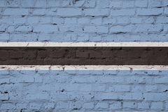 The flag of Botswana. Texture of a flag of Botswana on a pink brick wall Stock Photo